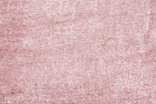 Z grubsza różowe złoto pomalowane tło powierzchni ściany betonowej