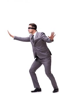 Z zasłoniętymi oczami biznesmen odizolowywający na bielu