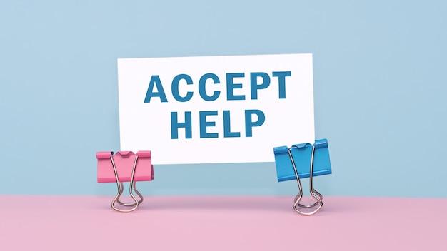 Zaakceptuj pomoc - koncepcja tekstu na wizytówce na różowym i niebieskim tle.