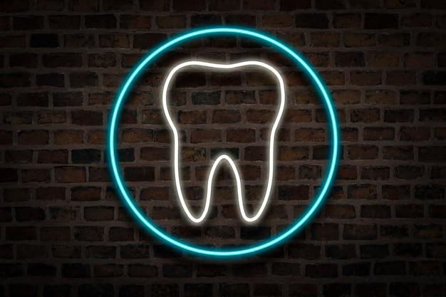 Ząb, neonowy znak na ściana z cegieł. koncepcja kliniki dentystycznej, pierwsza pomoc.