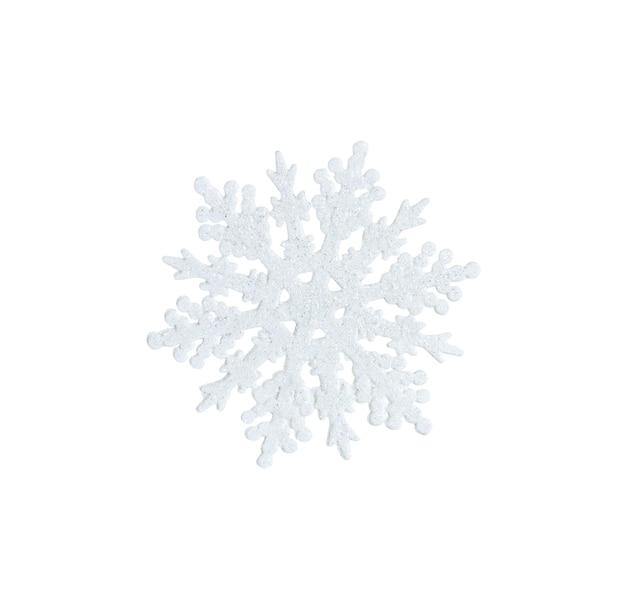 Zabawka biały śnieżynka z błyszczy na białym tle.