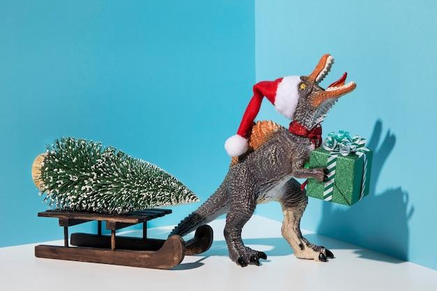 Zabawka tyrannosaurus rex z prezentem