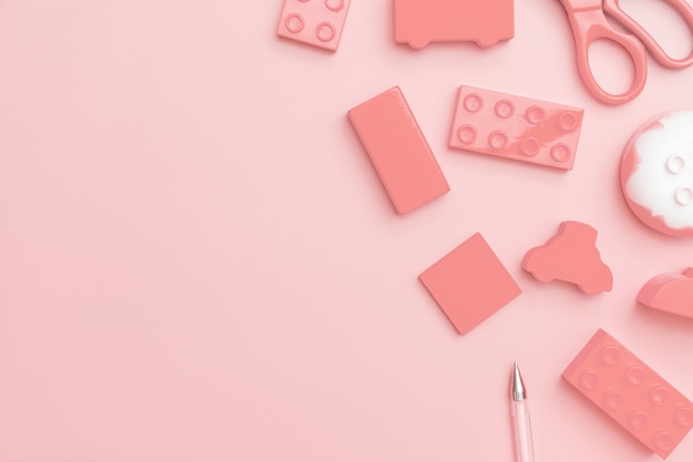 Zabawki dla dzieci na różowym tle z zabawkami płaskie leżał widok z góry z pustym centrum