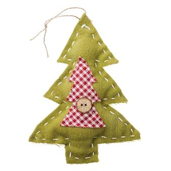 Zabawkowa jodła jako dekoracja świątecznych świąt na białym tle
