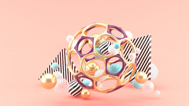 Zabawkowa piłka wśród kolorowych piłek na różowej przestrzeni