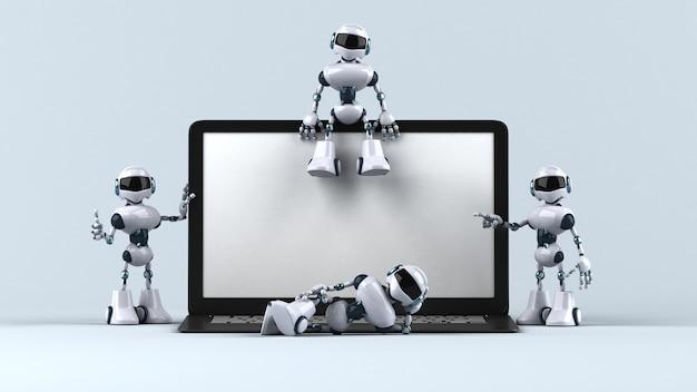 Zabawne roboty obok laptopa