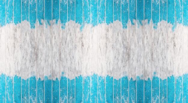 Zabytkowa niebieska i biała ściana pomalowana na kolor drewna