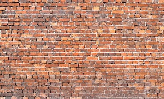 Zabytkowy mur. mur z czerwonej cegły, tło dla projektu