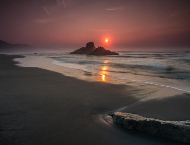 Zachód słońca w sablon