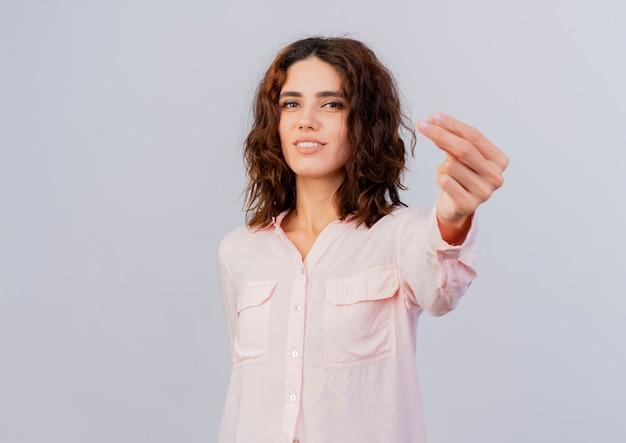Zadowolona młoda dziewczyna kaukaski gesty pieniądze ręka znak