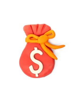 Zagraj w ciasto dolar moneybag na białym tle.