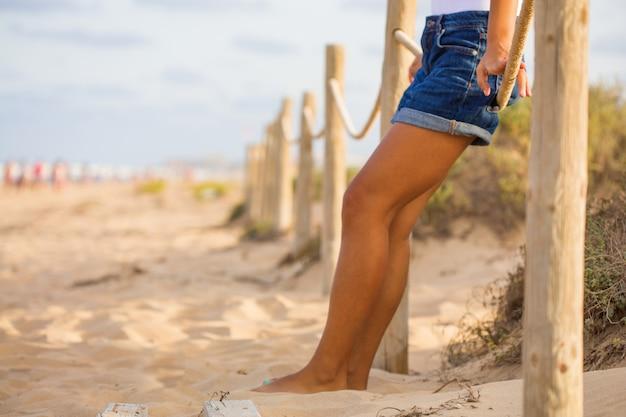 Zakończenie nogi na plaży