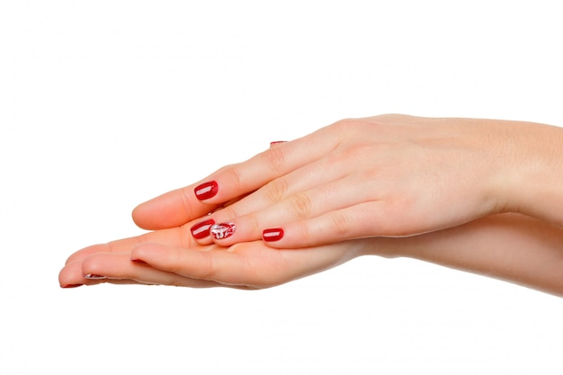 Zakończenie piękne kobiet ręki, dłonie w górę. pojedynczo na białym