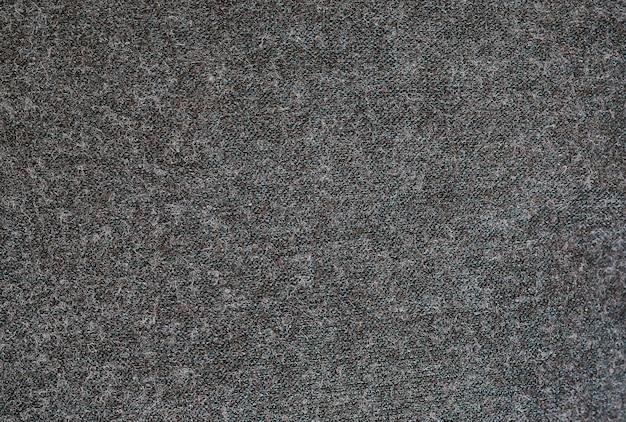 Zakończenie powierzchnia ciemnoszary filcujący tkaniny tekstury tło.