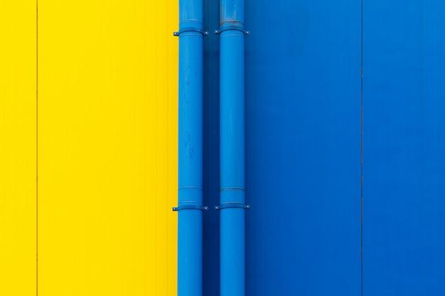 Zakończenie żółte i błękitne powierzchnie oddzielone drymbami, tło