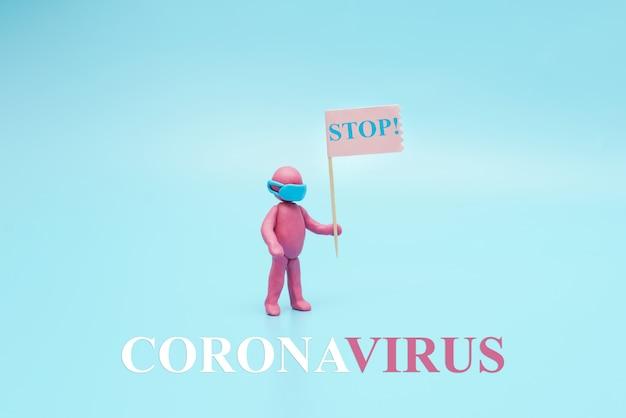 Zamaskowany plastelina broni się przed wirusem lub koronawirusem