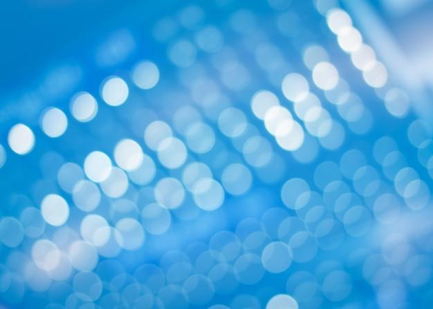 Zamazany błękitny bokeh światła abstrakt