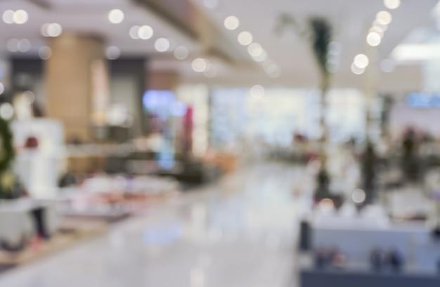 Zamazany zakupy centrum handlowego lub wydziałowego sklepu tła bokeh wewnętrzny światło