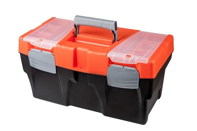 Zamknięta skrzynka narzędziowa wykonana z tworzywa sztucznego w kolorze czarnym i pomarańczowym.