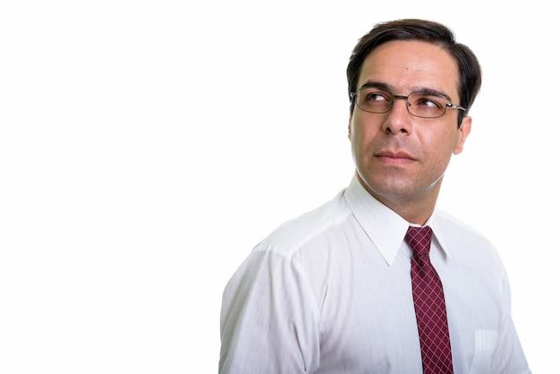 Zamknij się młody biznesmen perski myśli w okularach