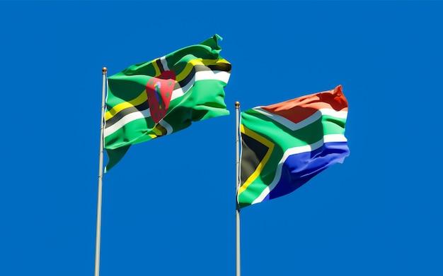 Zamknij się na flagach sar afryki i dominiki