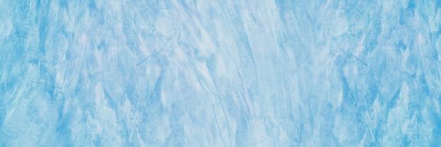 Zamknij się na miękkim niebieskim tle tekstury betonu