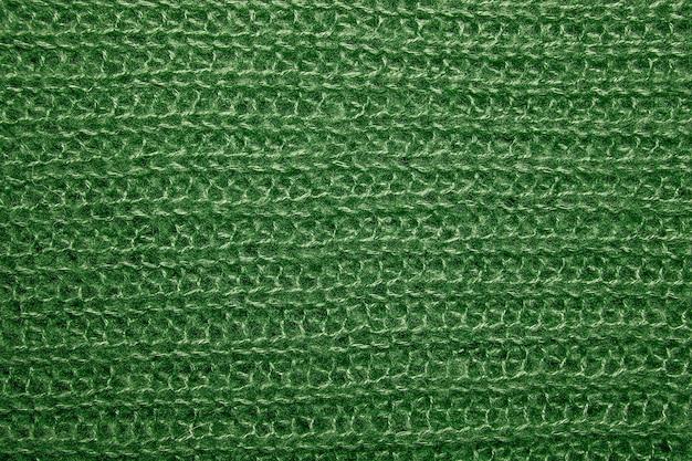 Zamknij się na tekstury dzianiny wełniane futro. zielony sweter z puszystej tkaniny jako tło.