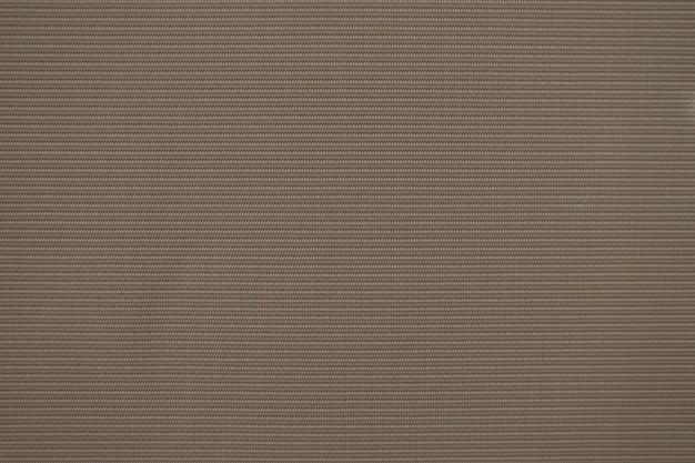 Zamknij się wzór brązowy zasłony tekstury tkaniny na tle.