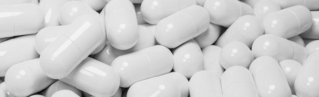 Zamknij się z wielu kapsułek białych tabletek