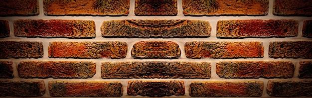 Zamknij się zdjęcie ceglanego muru, tekstury tła, obrazu panoramicznego