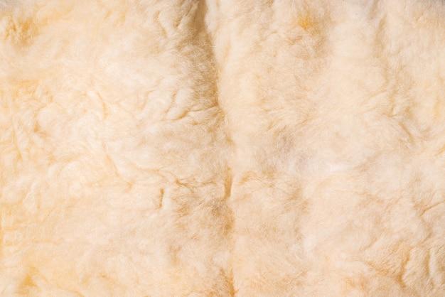 Zamknij się zdjęcie tekstury tkaniny białej wełny