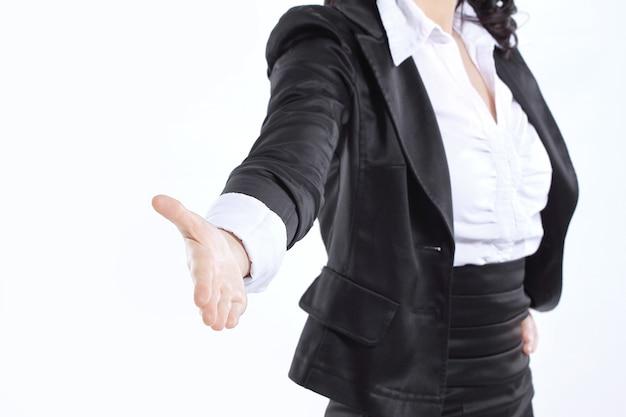 Zamknij up.hand kobieta biznesu wyciągnięta do uścisku dłoni. na białym tle