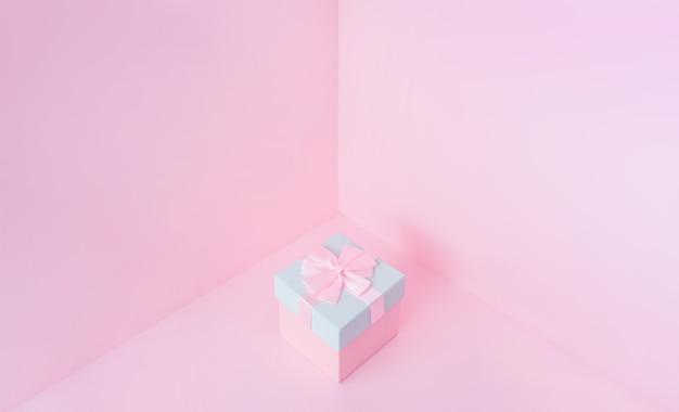 Zamknij widok minimalny skład różowego pudełka na prezenty świąteczne na pastelowym tle.