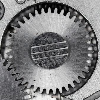 Zamknij widok starego mechanizmu zegara z zębatkami i zębatkami dla udanego projektu biznesowego makro