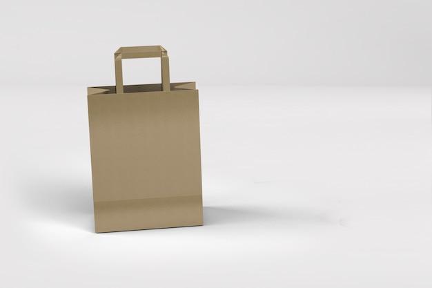 Zamknij widok torby na zakupy z papieru rzemieślniczego z uchwytami na białym on