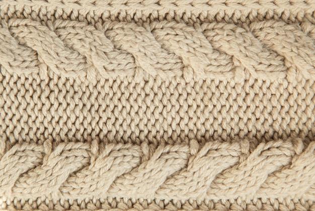 Zamyka up beżowy trykotowy zima pulower jako textured materialny pojęcie.