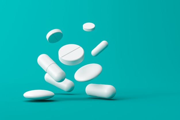 Zamyka up białe pigułki lub aspiryn pastylki na zielonym tle z pojęciem i apteką. biała kapsułka lub narkotyki. renderowanie 3d.