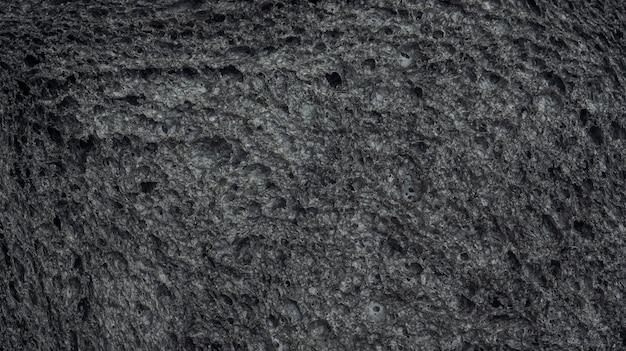 Zamyka up czarnego węgla drzewnego chleb dla tła.
