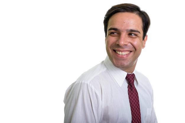 Zamyka up młody szczęśliwy biznesmen perski uśmiecha się i myśli