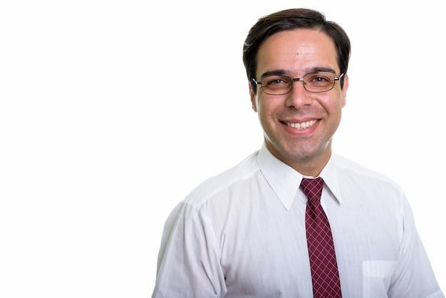 Zamyka up młody szczęśliwy biznesmen perski uśmiecha się z okularami