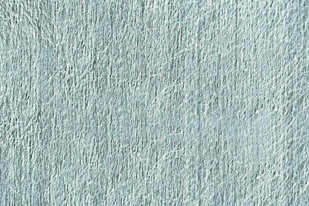 Zamyka up zielona porysowana betonowej ściany tekstura