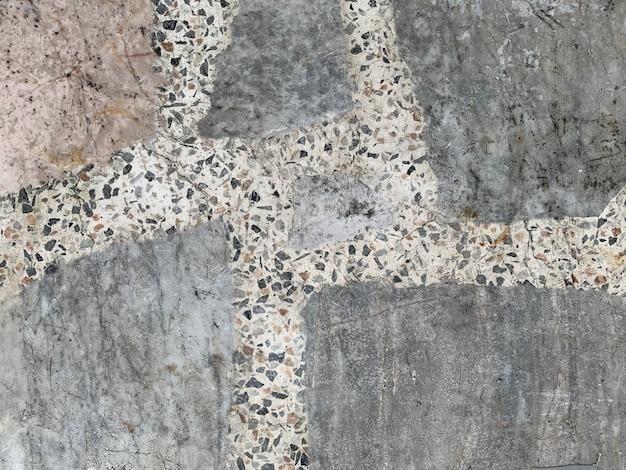 Zamyka w górę brudnej nieociosanej starej cement ściany