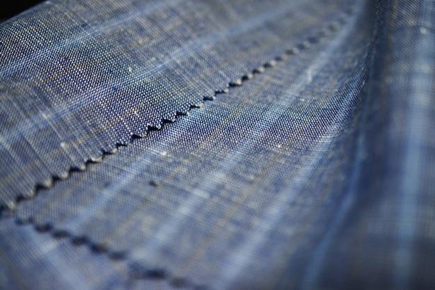 Zamyka w górę drelichowej tekstury tkaniny kostium, photoshoot głębią pole dla przedmiota