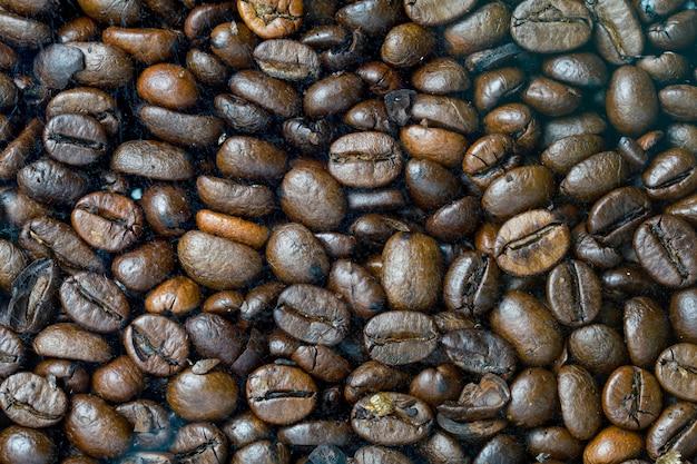Zamyka w górę kawy ziarna dla tła