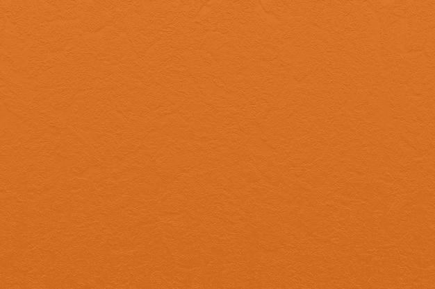 Zamyka w górę pomarańcze papieru tekstury tła