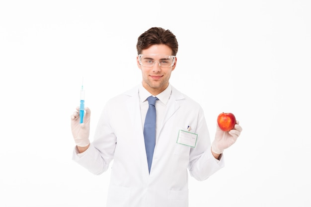 Zamyka w górę portreta uśmiechnięta młoda samiec lekarka