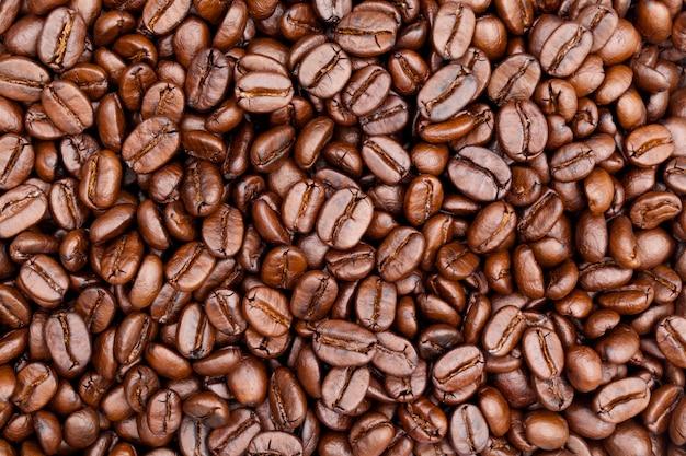 Zamyka w górę strzału brown pieczonej kawy tekstury tło