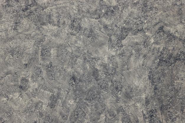 Zamyka w górę szarej betonowej tekstury dla tła