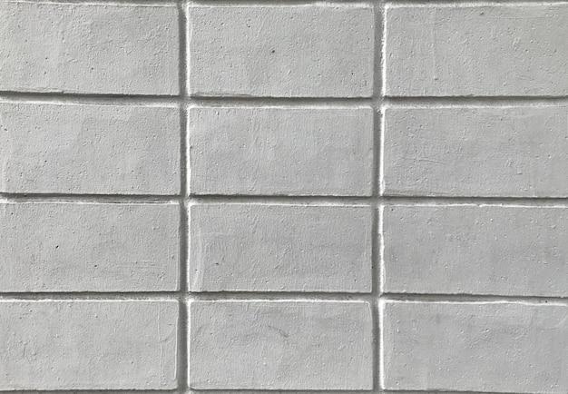 Zamyka w górę tekstury biały ściana z cegieł dla tła