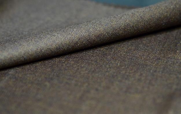 Zamyka w górę tekstury brown tkaniny kostium, photoshoot głębią pole dla przedmiota